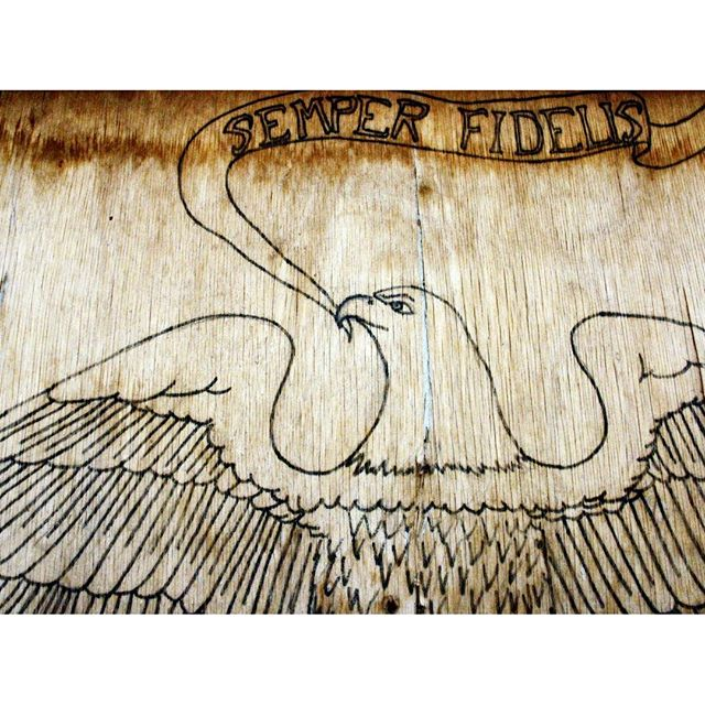 """""""Semper Fidelis on Wood."""" A design on a Rawah's chow hall (well, more of a chow uh bungalow) door. I actually have this photograph turn into a very large fine art print on canvas. It's in storage gathering dust as we speak along with about thousands of dollars worth of art. 😕"""