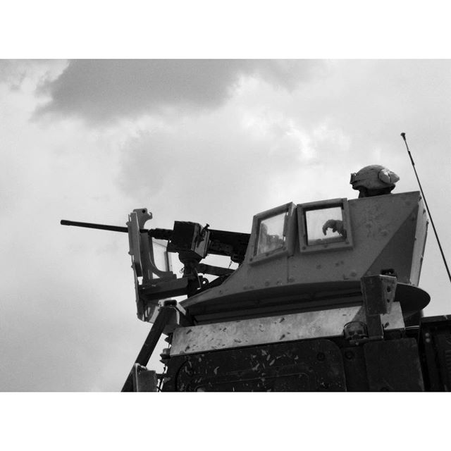 """""""Turret Gunner."""" When I was the turret gunner, I had a MK-19 (the grenade launcher) and a turret that didn't lock in place. Keeping the weapon pointed in the right direction took my entire body as the armored truck bounced along uneven roads and off-road obstacles. It also didn't have a thing to hold the ammo can feeding the belt of grenades into the weapon. I ended up using 550-cord to create a flimsy rig to hold a can in place on top of this truck."""